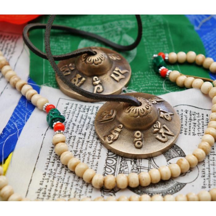Bronze karatals Om Mani 5.5cm.